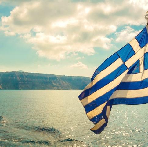 Vintage image of Greek flag and back light, Mediterranean sea, Greece